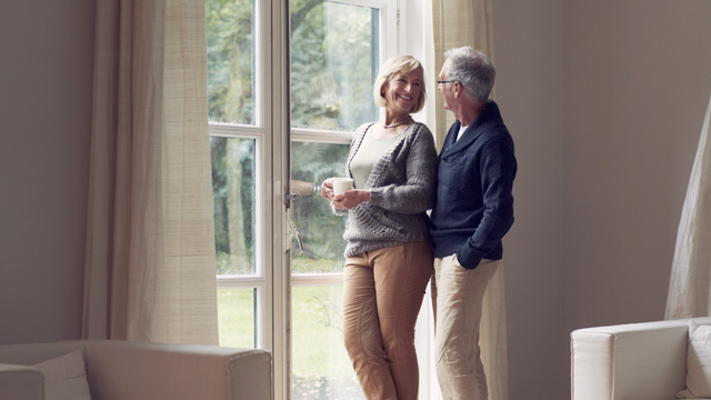 Older couple standing by the window