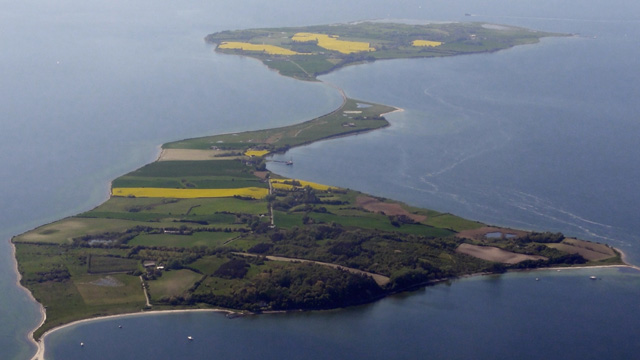 Two islands with green fields