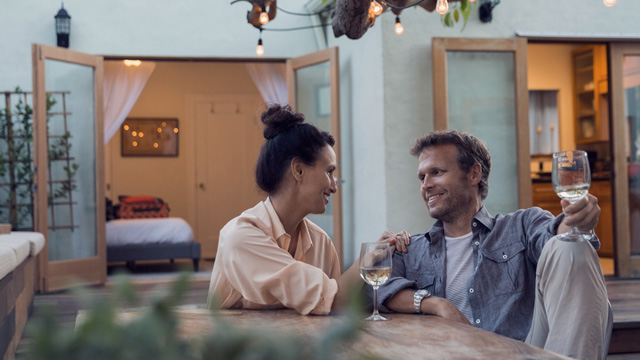 Couple enjoying a glass of wine indoors
