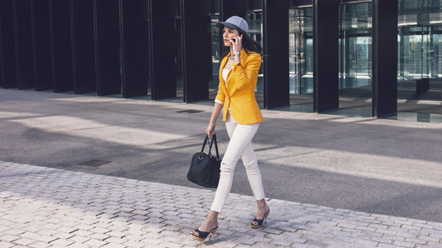 Woman in orange blazer