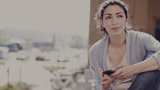 Casual woman with phone outside 1 small
